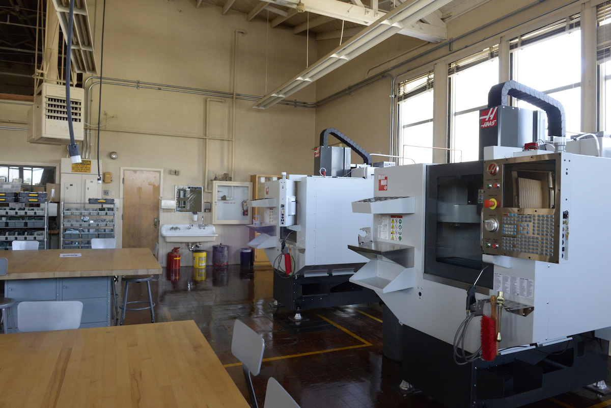 New Sato Academy building with manufacturing equipment